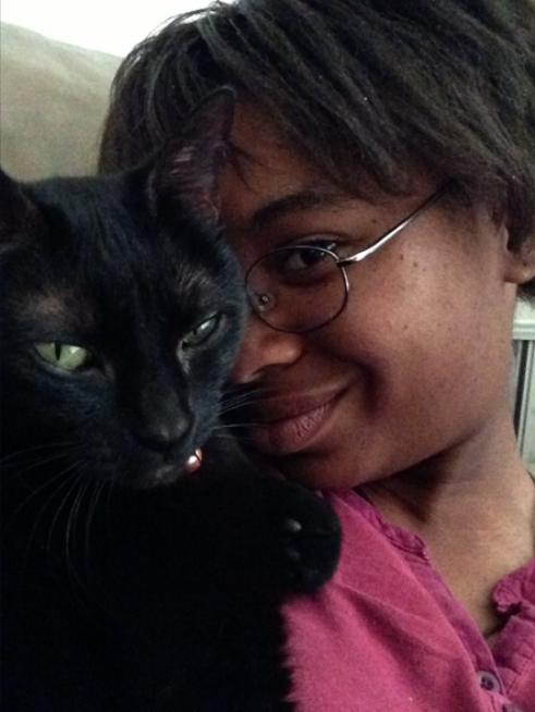 plaugekoneko19 with her cat Shadow.
